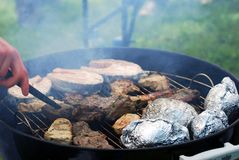 Cooking on a barbecue. Royalty Free Stock Images