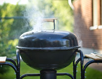 Cooking in a barbecue stock photo