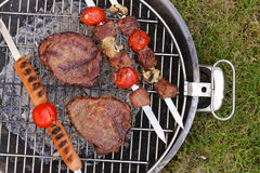 Cooking on the barbecue grill assortment  steak and skewers Stock Photo