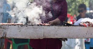 Cooking barbecue on the grill in the open air Stock Images