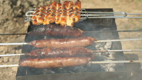 Cooking of barbecue on the grill outdoors. Close-up stock footage