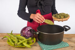 Cooking with bay leaves Stock Photos