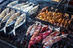 Cooking BBQ seafood on background fire Royalty Free Stock Image