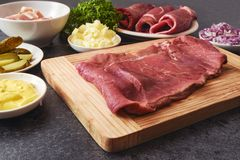 Cooking beef roulades with the ingredients as mustard, onions, p Stock Images