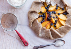Cooking biscuits with peach and blueberry, top view. Cooking biscuits with peach and blueberry on a white table with Stock Photos