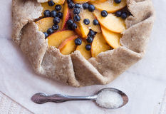 Cooking biscuits with peach and blueberry. On a white table Royalty Free Stock Photos