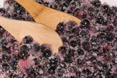 Cooking black currants. In the rural kitchen Royalty Free Stock Photography