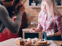 Cooking blog hobby lifestyle sweet bakery products. Cooking blog. Hobby and lifestyle. Man and women shooting marshmallow. Sweet bakery products around royalty free stock image