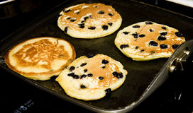 Cooking Blueberry Pancakes Royalty Free Stock Photos