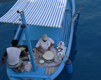 Cooking in the boat. An old woman prepare pastries in a boat, turkey Stock Images