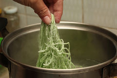 Cooking ,Boiled green noodle in pot with pork& x27;s bone soup . Royalty Free Stock Photography