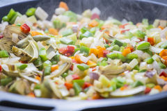 Cooking boiling Mediterranean veggies on a pan Stock Images