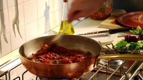 Cooking bolognese meat sauce stock video