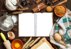 Cooking book and utensils Stock Images