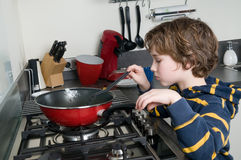 Cooking Boy Stock Images
