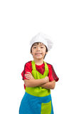 Cooking boy cross his arm Stock Image