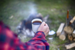 Cooking breakfast on a campfire at a summer camp. Stock Photos