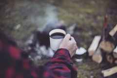 Cooking breakfast. Cooking breakfast on a campfire at a summer camp Stock Photo