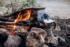 Cooking breakfast on a campfire at a summer camp. royalty free stock photos