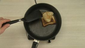 Cooking of breakfast with fried egg and toast stock video footage