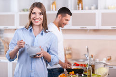 Cooking breakfast together. Royalty Free Stock Photography
