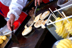 Cooking buns at the market Royalty Free Stock Photography