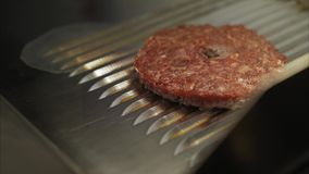 Cooking burgers on hot grill with flames. stock footage