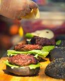 Cooking burgers at a picnic Stock Photo