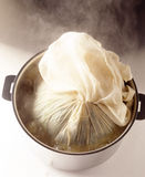 Cooking the cabbage in a cloth Royalty Free Stock Photo