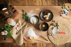 Cooking cake on the table and baking cake ingredients. Cooking cake on table and baking cake ingredients royalty free stock images