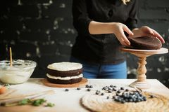 Cooking cake on the table and baking cake ingredients. Cooking cake on table and baking cake ingredients royalty free stock image