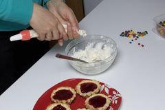 Cooking cakes at home. Cooking cakes. Woman Lays the cream in a culinary bag Stock Images