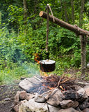 Cooking in caldron. Cooking in the sooty cauldron on the open fire in woods stock photography