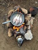 Cooking at camp Stock Photos