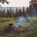 Cooking on campfire during hicking in mountains stock photos