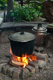 Cooking on campfire Royalty Free Stock Photography