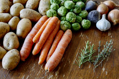 Cooking with carrots potatoes and sprouts Stock Photography