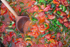 Cooking casseroles. Cooking tomatoes, peppers and onions Stock Images