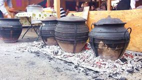Cooking in ceramic pots stock video footage