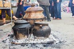 Cooking in ceramic pots Stock Photos