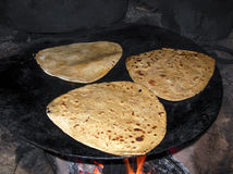 Cooking Chapati. Indian cooking delicious handmade restaurant chapati on hot tawa Royalty Free Stock Images