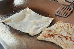 Cooking chapati on the pan Stock Photography