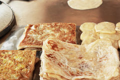 Cooking chapati on the table Stock Photo