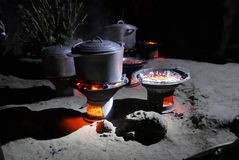 Cooking with charcoal in Madagascar Royalty Free Stock Images