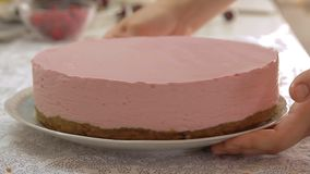 Cooking cheese cake. With cherry and raspberry on the kitchen table video footage stock footage