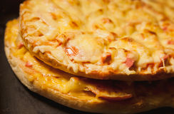 Cooking cheese pizza in a hot oven Stock Image