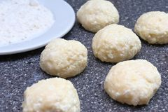 Cooking cheesecakes. Balls from cottage cheese dough, flour. Fragrant ruddy golden with a brown crust freshly cooked syrup curds stock photography