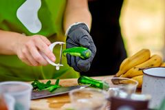 Cooking, Chef Cutting cucumber on hardboard and healthy food, Cutting cucumber slices on board with a sharp knife close. Up. Street food Royalty Free Stock Photography