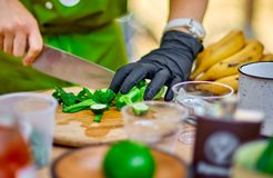 Cooking, Chef Cutting cucumber on hardboard and healthy food, Cutting cucumber slices on board with a sharp knife close. Up. Street food Stock Photos
