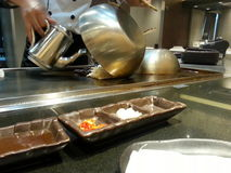 Cooking. Chef cooking food in Japanese restaurant royalty free stock photo